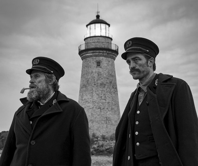 "This image released by A24 shows Willem Dafoe, left, and Robert Pattinson in a scene from ""The Lighthouse"", a film about an aging lighthouse keeper in Maine. (Photo by A24 via AP Photo)"