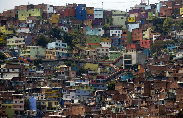 "View of ""Comuna 13"" shantytown, one of the poorest areas of Medellin, Antioquia department, Colombia on April 1, 2014, ahead of the World Urban Forum 7, which will take place from April 5 to 11. Medellin was chosen by popular vote through the internet as ""Innovative City of the Year"" in a contest organized by The Wall Street Journal and Citigroup in 2013. The distinction was basically made for its modern transportation system, public library, escalators built in a shantytown and schools that have allowed the integration of society. (Photo by Raul Arboleda/AFP Photo)"