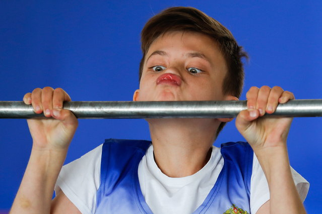 A boy doing chin-ups as he takes entrance exams at the Moscow Suvorov Military School in Moscow, Russia on July 11, 2019. (Photo by Sergei Karpukhin/Russian News Agency TASS via Getty Images)