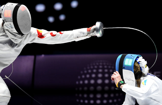 Lin Sheng of China (L) and Olena Kryvytska of Ukraine fight in the women's individual epée semifinal of the FIE World Fencing Championships in Budapest, Hungary, 18 July 2019. (Photo by Balazs Czagany/EPA/EFE)