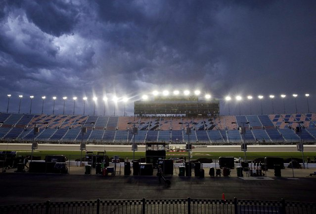 Dark clouds move across the sky before the NASCAR Xfinity series auto race at Chicagoland Speedway, Saturday, June 20, 2015, in Joliet, Ill. (AP Photo/Nam Y. Huh)