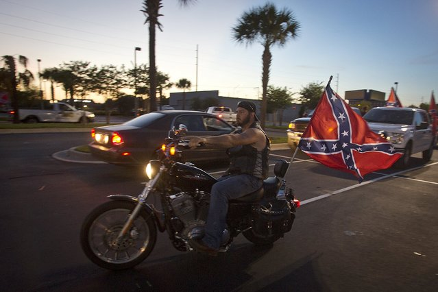 "A man rides a motorcycle during the ""Ride for Pride"" impromptu event to show support for the Confederate flag in Brandon, Hillsborough County, June 26, 2015. (Photo by Carlo Allegri/Reuters)"