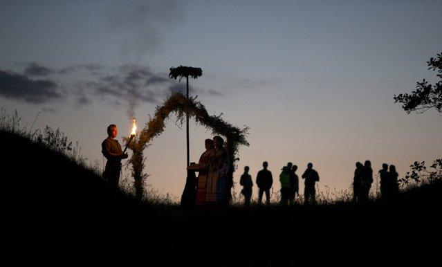 Belarusian people take part in the Ivan Kupala festival near the town of Rakov, west of Minsk June 27, 2015. (Photo by Vasily Fedosenko/Reuters)