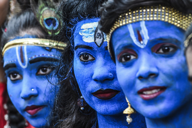 Students dressed up as Hindu gods Lord Krishna and Lord Shiva participate in a cultural event in their school in Mumbai on August 21, 2019. (Photo by Indranil Mukherjee/AFP Photo)
