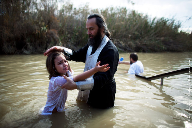 Orthodox Christian pilgrims are baptized during Epiphany celebrations in the Jordan River