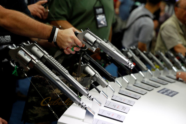 Attendees visit the trade booths during the National Rifle Association's annual meeting in Louisville, Kentucky, May 21, 2016. (Photo by Aaron P. Bernstein/Reuters)
