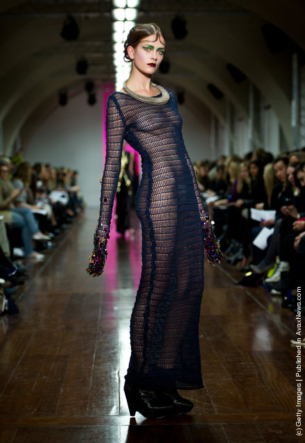 A model walks the runway during the Fyodor Golan show at London Fashion Week Autumn/Winter 2012 at Somerset House