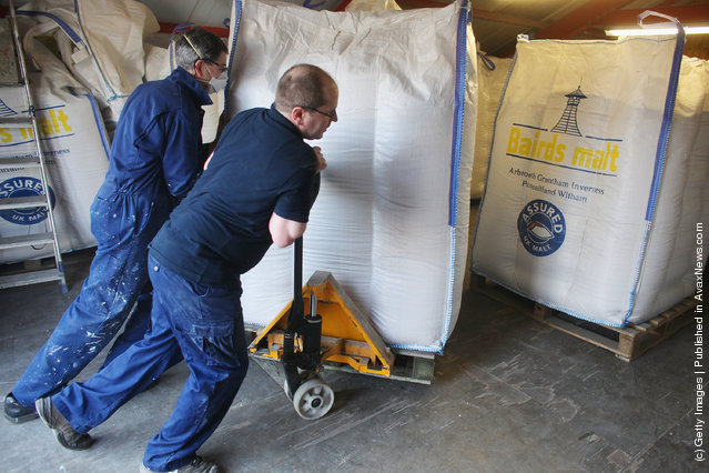 Jimmy Kennedy and Bose Mathias bring in a delivery of malt at Edradour distillery on March 26, 2012 in Pitlochry, UK