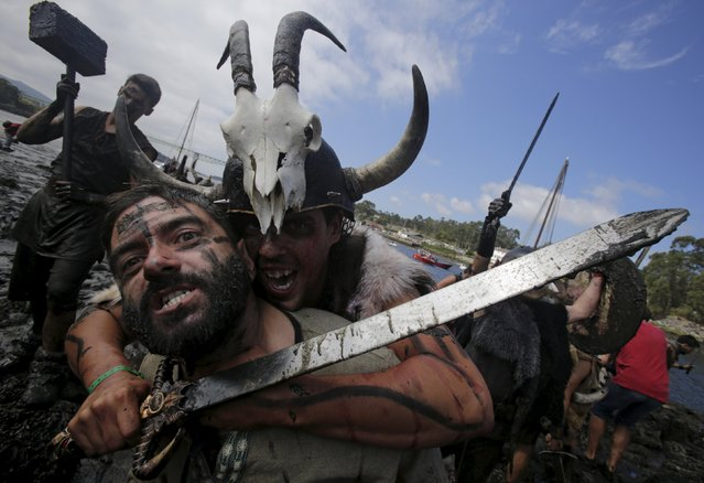 People dressed up as Vikings take part in the annual Viking festival of Catoira in north-western Spain August 2, 2015. The festival re-enacts past Viking raids in the area and is celebrated annually on the first Sunday in August. (Photo by Miguel Vidal/Reuters)