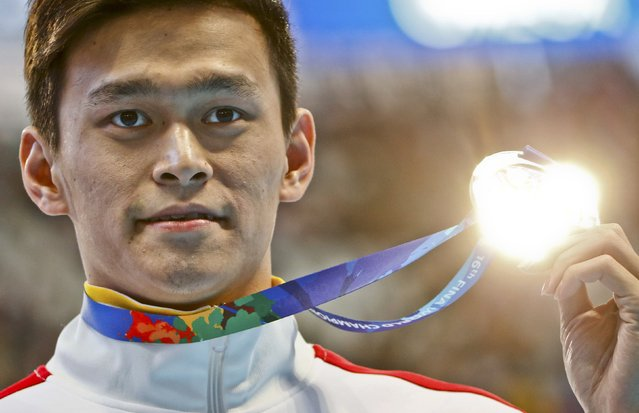 Sun Yang of China displays his silver medal after the men's 200m freestyle final at the Aquatics World Championships in Kazan, Russia August 4, 2015. (Photo by Hannibal Hanschke/Reuters)