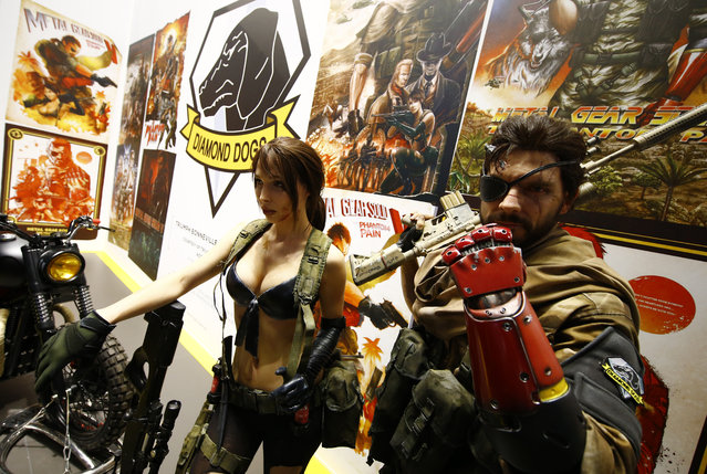 """Models promote the game """"Diamond Dogs"""" produced by Konami during the Gamescom 2015 fair in Cologne, Germany August 5, 2015. (Photo by Kai Pfaffenbach/Reuters)"""