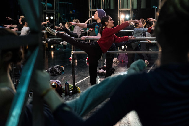 """Miranda Dafoe warms up before her performance as the Nutcracker in Dayton Ballet's production of """"The Nutcracker"""" in Dayton, Ohio on December 21, 2019. For the first time in professional dance history, according to Dayton Ballet's artistic director, a female, 23-year-old ballet dancer Miranda Dafoe, has been cast in the role of the Nutcracker. Once Dafoe's nutcracker head is removed during the performance, her identity as a female soldier is revealed and she becomes a guiding or motherly figure to Clara. (Photo by Megan Jelinger/AFP Photo)"""