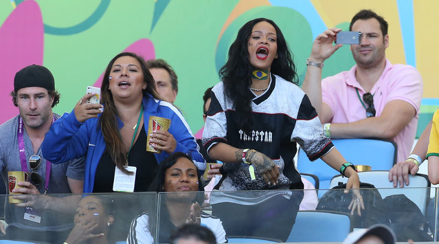 Rihanna attends the 2014 FIFA World Cup Brazil Final match between Germany and Argentina at Estadio Maracana on July 13, 2014 in Rio de Janeiro, Brazil. (Photo by Jean Catuffe/Getty Images)