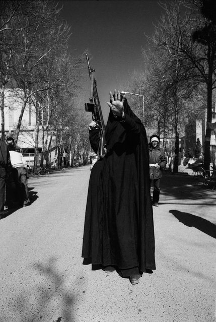 Tehran on February 12, 1979. A woman dressed in a black chador and carrying a G3 machine gun, holds up her hand in a gesture of defiance to the camera. She is among the forces occupying Tehran University a day after the triumph of the Islamic Revolution, led by Ayatollah Khomeini. Kaveh Kazemi's shots of the revolution launched his career. Iran: Year 38 is at Les Rencontres d'Arles photographic festival, 3 July-24 September. (Photo by Kaveh Kazemi/The Guardian)