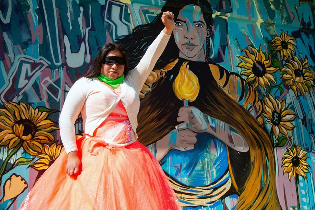 A student poses for a photo in front of a new mural after taking part in a performance against gender violence, as part of a joint project of the European Union (UE) and the United Nations (UN) under the Spotlight Initiative to eliminate all forms of violence against women and girls, at a high school in Ecatepec de Morelos, which is one of the most dangerous municipalities on the outskirts of Mexico City, Mexico on December 7, 2019. (Photo by Nadya Murillo/Reuters)