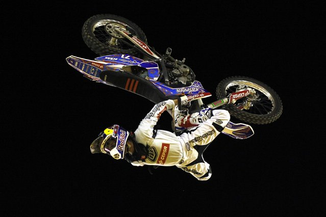 Spanish rider Dani Torres performs a jump during the Burn Freestyle Malaga motocross show at the Malagueta bullring in Malaga, southern Spain, early July 27, 2014. (Photo by Jon Nazca/Reuters)