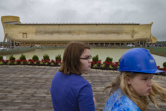Visitors roam the Ark Encounter theme park as a replica of Noah's Ark stands in the distance during a media preview day, Tuesday, July 5, 2016, in Williamstown, Ky. (Photo by John Minchillo/AP Photo)
