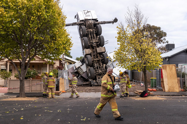 This picture has been selected as one of the Best of the Year News images for 2019* A crane is seen after it collapsed on two houses in Yarraville, Melbourne, Wednesday, April 10, 2019. (Photo by Daniel Pockett/AAP Image)
