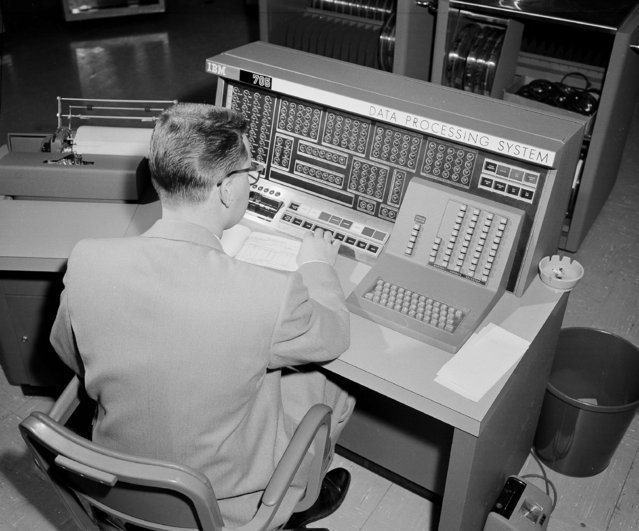 Owen Charles console operator for the electronic data processing system is pictured at work, March 20, 1958, in Mare Island shipyard, Vallejo, Calif. (Photo by Clarence Hamm/AP Photo)