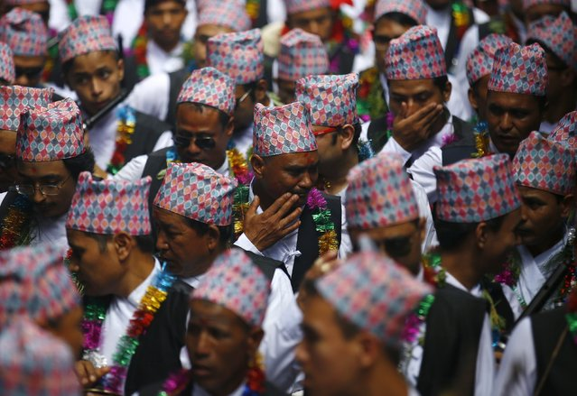 Devotees in traditional attire take part in a parade commemorating the Neku Jatra-Mataya festival, the Festival of Lights, in Lalitpur, Nepal August 31, 2015. (Photo by Navesh Chitrakar/Reuters)
