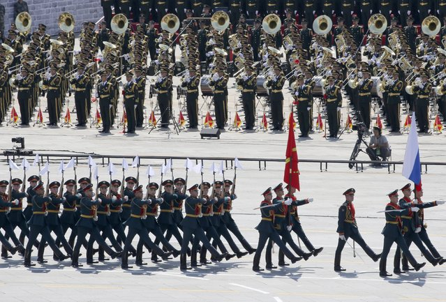 Russian soldiers march as the military band plays during a military parade to mark the 70th anniversary of the end of World War Two, in Beijing, China, September 3, 2015. (Photo by Reuters/China Daily)