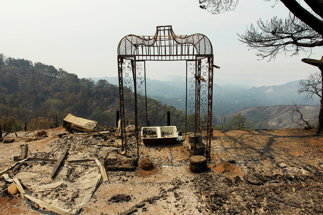 A garden structure is seen at the site of a destroyed home after the Soberanes Fire burned through the Palo Colorado area, north of Big Sur, California, July 31, 2016. (Photo by Michael Fiala/Reuters)