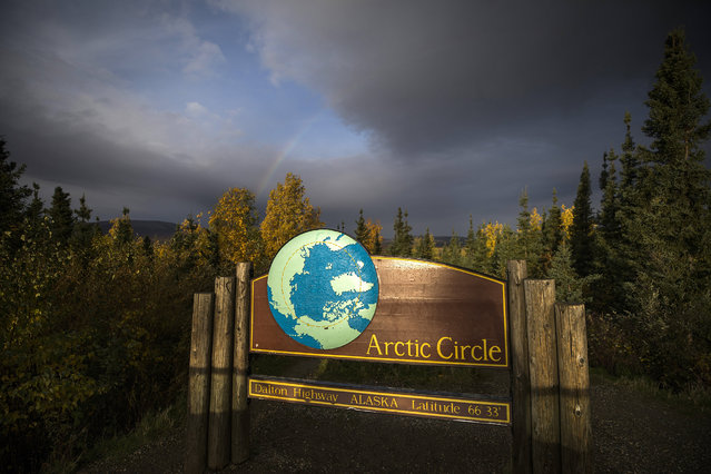 A sign along the Dalton Highway marks the Arctic Circle near Prospect Creek, Alaska, USA, 07 September 2017. (Photo by Jim Lo Scalzo/EPA)