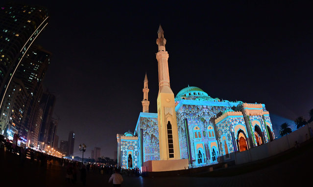 Al-Noor Mosque is lit up in a colourful display for the 10th annual Sharjah Light Festival in the Emirate of Sharjah, on February 7, 2020. (Photo by Giuseppe Cacace/AFP Photo)
