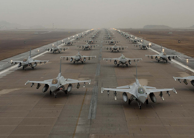 F-16 Fighting Falcons taxi down the flightline at Kunsan Air Base, South Korea. (Photo by USAF)