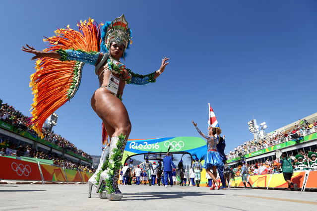 A dancer performs during the Women's Marathon on Day 9 of the Rio 2016 Olympic Games at the Sambodromo on August 13, 2016 in Rio de Janeiro, Brazil. (Photo by Alexander Hassenstein/Getty Images)