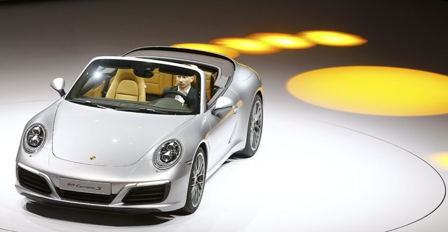 New Porsche 911 Carrera S cabrio car is presented during the Volkswagen group night ahead of the Frankfurt Motor Show (IAA) in Frankfurt, Germany, September 14, 2015. (Photo by Kai Pfaffenbach/Reuters)