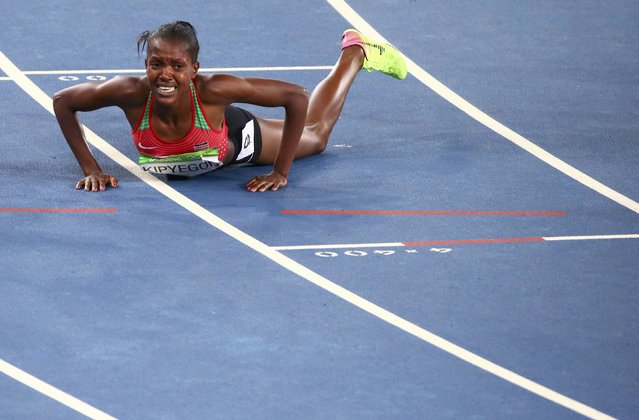 2016 Rio Olympics, Athletics, Final, Women's 1500m Final, Olympic Stadium, Rio de Janeiro, Brazil on August 16, 2016. Faith Chepngetich Kipyegon (KEN) of Kenya reacts on track after winning the final. (Photo by David Gray/Reuters)