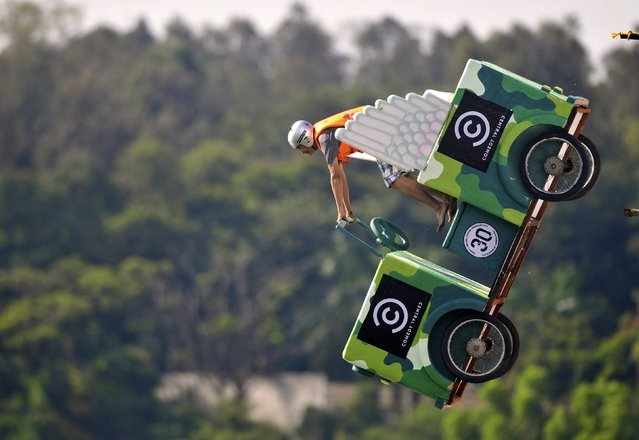 A participant operates a homemade human-powered flying machine during the Red Bull Flugtag (Flight Day) event in the southern Indian city of Bangalore September 28, 2014. Participants from 32 teams competed to fly the longest distance in their homemade human-powered flying machines on Sunday. (Photo by Abhishek N. Chinnappa/Reuters)