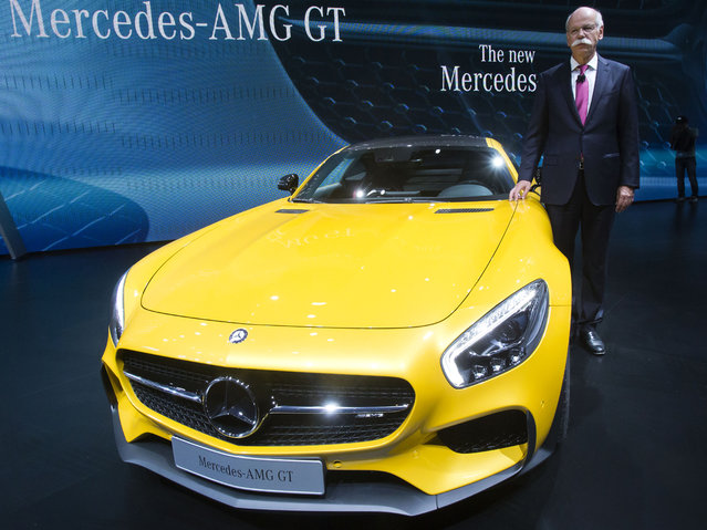 Daimler CEO Dieter Zetsche poses next to the new Mercedes AMG GT car during the press day at the Motor Show in Paris, France, Thursday, October 2, 2014. (Photo by Michel Euler/AP Photo)