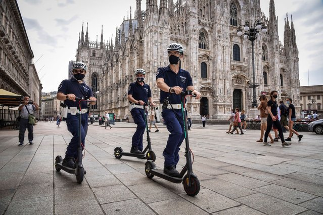 Local police officers on scooters patrol in piazza Duomo, in Milan, Italy, 26 June 2020. The new service of the Local Police on ​a scooter is dedicated to the control of pedestrian areas and cycle paths. (Photo by Matteo Corner/EPA/EFE)