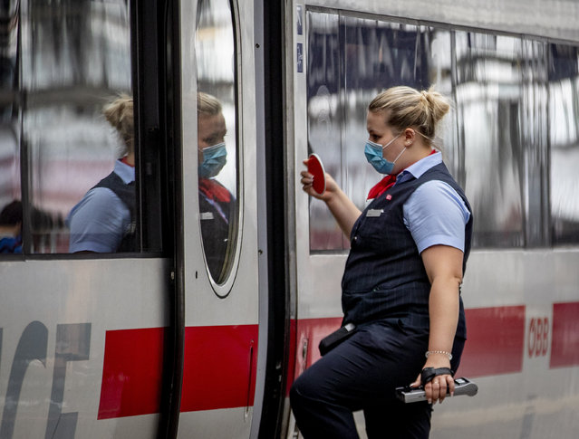 A conductor enters a train in the central train station in Frankfurt, Germany, Monday, June 29, 2020. (Photo by Michael Probst/AP Photo)