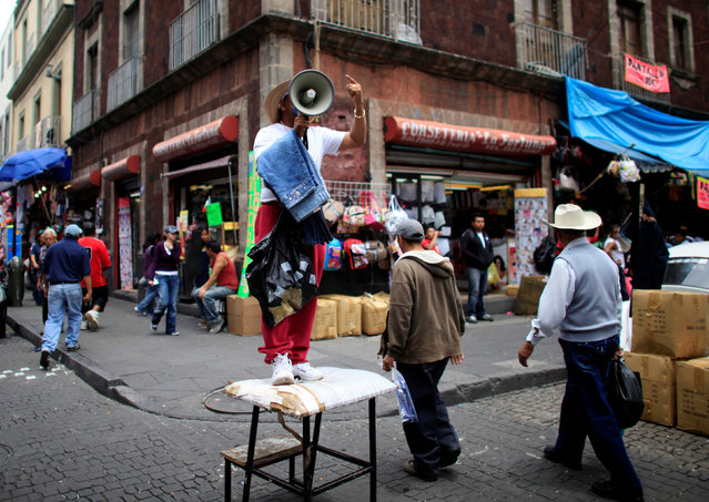 A man sells jeans in downtown Mexico City, Mexico August 23, 2010. (Photo by Eliana Aponte/Reuters)