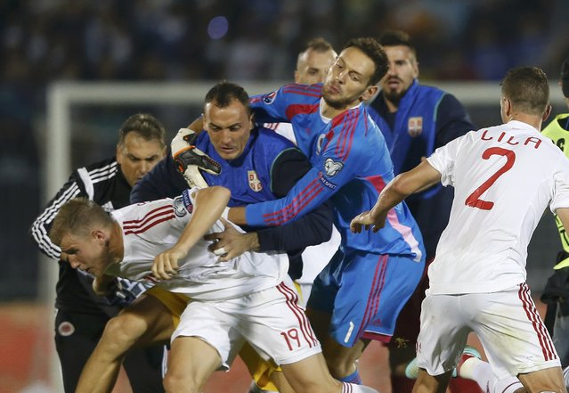 Albania's Bekim Balaj (L) and his teammate Andi Lila (R) scuffle with Serbia's players during their Euro 2016 Group I qualifying soccer match at the FK Partizan stadium in Belgrade October 14, 2014. (Photo by Marko Djurica/Reuters)
