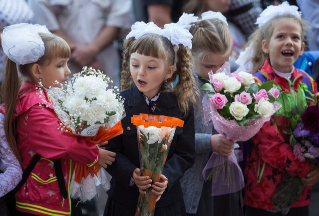 The new school year starts in Russia as 1st grade students attend a ceremony marking Knowledge Day at School 130 in Omsk on September 1, 2016. (Photo by  Dmitry Feoktistov/TASS)