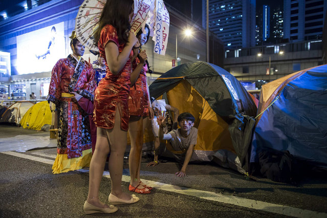 Pro-democracy protesters wearing costumes pose for a photo during Halloween, on a main road which they have blocked, at Admiralty district in Hong Kong October 31, 2014. (Photo by Tyrone Siu/Reuters)