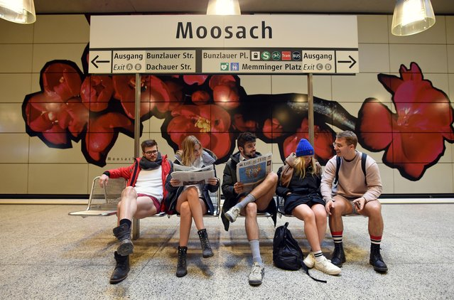 """Participants in the """"No Pants Subway Ride"""" sitting at Moosbach underground station in Munich, Germany, 7 January 2018. Every January, thousands of people around the world take part in the event, which originated in New York in 2002. (Photo by Andreas Gebert/DPA)"""