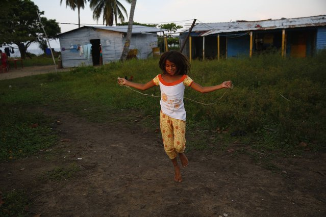 A girl skips with a rope in the village of Ologa in the western state of Zulia, Venezuela October 23, 2014. This year the Catatumbo Lightning was approved for inclusion in the 2015 edition of Guinness World Records, dethroning the Congolese town of Kifuka as the place with the world's most lightning bolts per square kilometer each year at 250. (Photo by Jorge Silva/Reuters)
