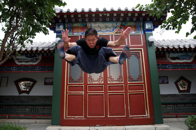 "Kung Fu master Xing Xi demonstrates his skills for the camera at his Kung Fu academy ""Kung Fu Zen"" in Beijing, China, July 3, 2016. (Photo by Kim Kyung-Hoon/Reuters)"