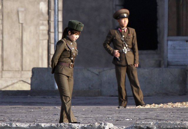 North Korean soldiers stand guard along the banks of the Yalu River near the North Korean town of Sinuiju, opposite the Chinese border city of Dandong, November 11, 2014. (Photo by Jacky Chen/Reuters)