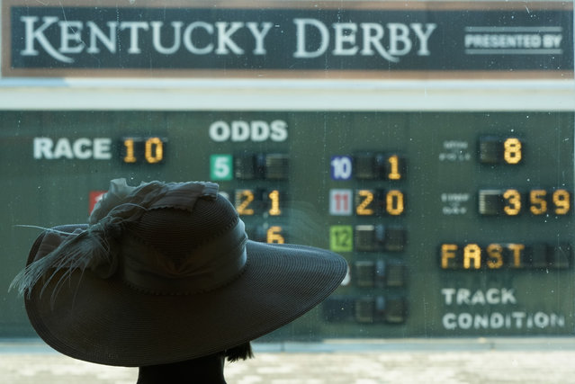 A woman looks out over the paddock before the 146th running of the Kentucky Derby at Churchill Downs, Saturday, September 5, 2020, in Louisville, Ky. (Photo by Charlie Riedel/AP Photo)