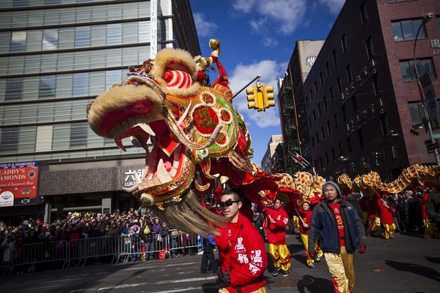 Dragon dancers cross Canal Street during the 14th Annual Chinatown Lunar New Year parade on February 17, 2013 in New York City. This year celebrates the Year of the Snake. (Photo by Michael Nagle)