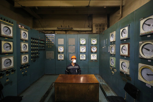 An employee works in a control centre of a chemical shop at a hydrometallurgical facility, part of Priargunsky Industrial Mining and Chemical Union (PIMCU) in Krasnokamensk, Transbaikal Territory, Russia on September 16, 2020. In terms of sales of 2B/3B grade brown coal, the Urtuisky open pit mine is one of the leading brown coal deposits in the Russian market. PIMCU is the largest uranium mining company in Russia and is a subsidiary of ARMZ Uranium Holding Co (Atomredmetzoloto), which is part of the Rosatom State Corporation. (Photo by Sergei Bobylev/TASS)