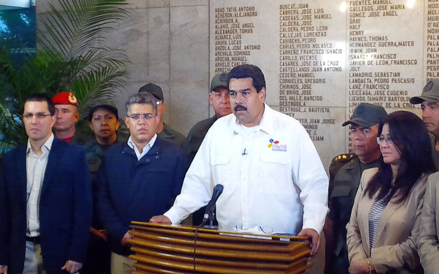 In this photo released by Miraflores Presidential Press Office, Venezuela's Vice President Nicolas Maduro addresses the nation to announce the death of President Hugo Chavez in Caracas, Venezuela, Tuesday, March 5, 2013. Maduro announced that Chavez has died on Tuesday at age 58 after a nearly two-year bout with cancer. (Photo by AP Photo/Miraflores Presidential Press Office)