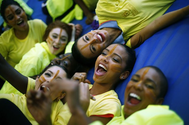 Competitors lie on a mat during a break between events at  the Miss World sports competition at the Lee Valley sports complex in north London, November 26, 2014. (Photo by Andrew Winning/Reuters)