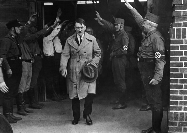 In this December 5, 1931 file photo Adolf Hitler, leader of the National Socialists, emerges from the party's Munich headquarters. Historical documents show Adolf Hitler enjoyed special treatment, including plentiful supplies of beer, during his time in Landsberg prison. (Photo by AP Photo)